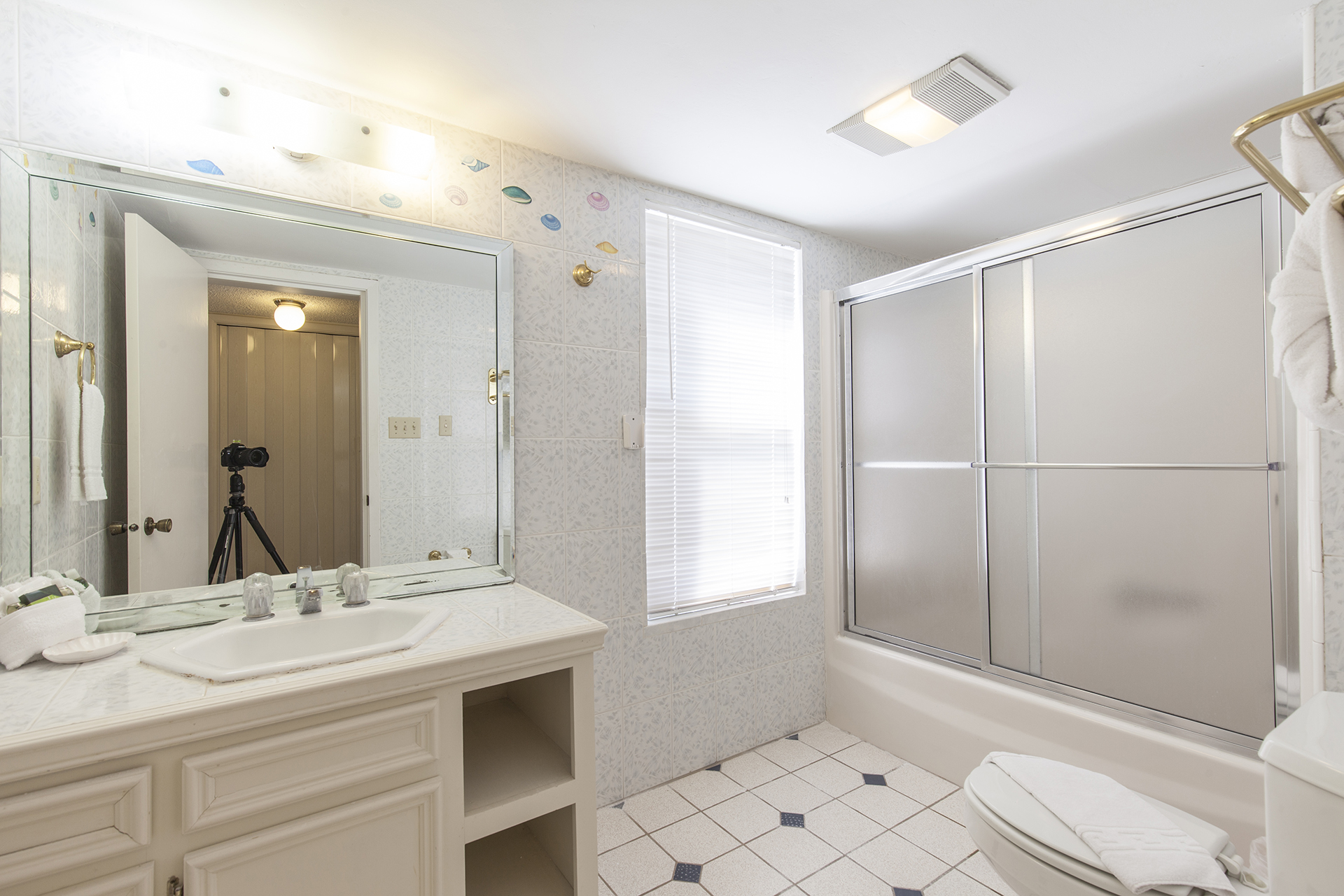Guest bathroom with shower tub combination.