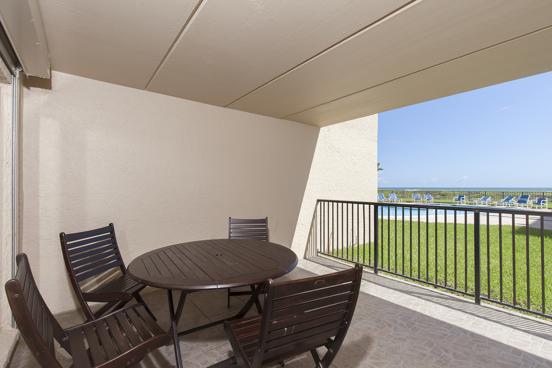 Spacious balcony with views to the beach.
