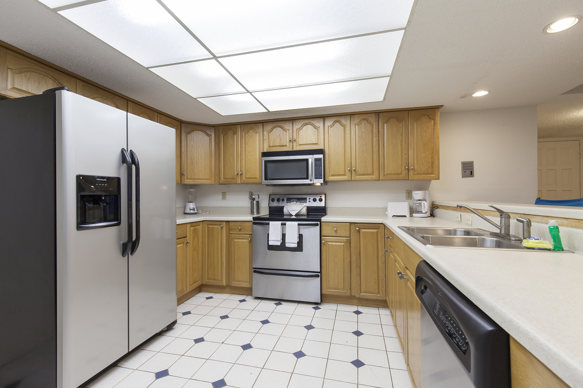 Spacious fully equipped kitchen with double door refrigerator.