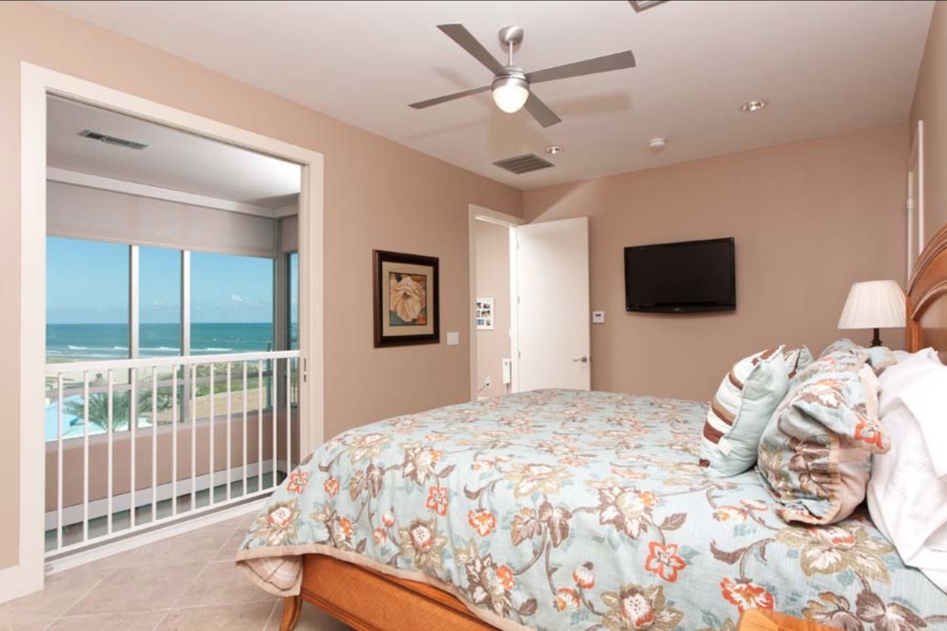 Master bedroom with partial views of the beach.