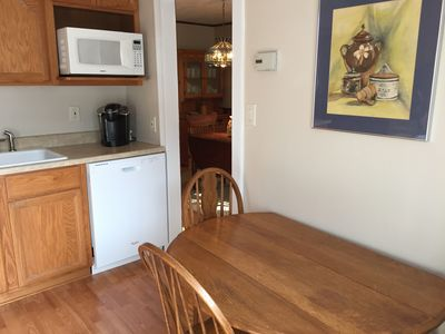 From the kitchen, you can enter the dining room.