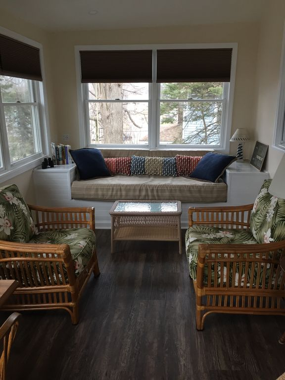 This is the porch.  It has been newly updated in the winter of 2018-2019 and has a lot of seating, a table (see other photos of porch) and ceiling fan, and many windows which let a lot of light in.  Many people have said this is their favorite room !