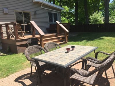 This is the deck coming off from the kitchen and the table with wicker seating.