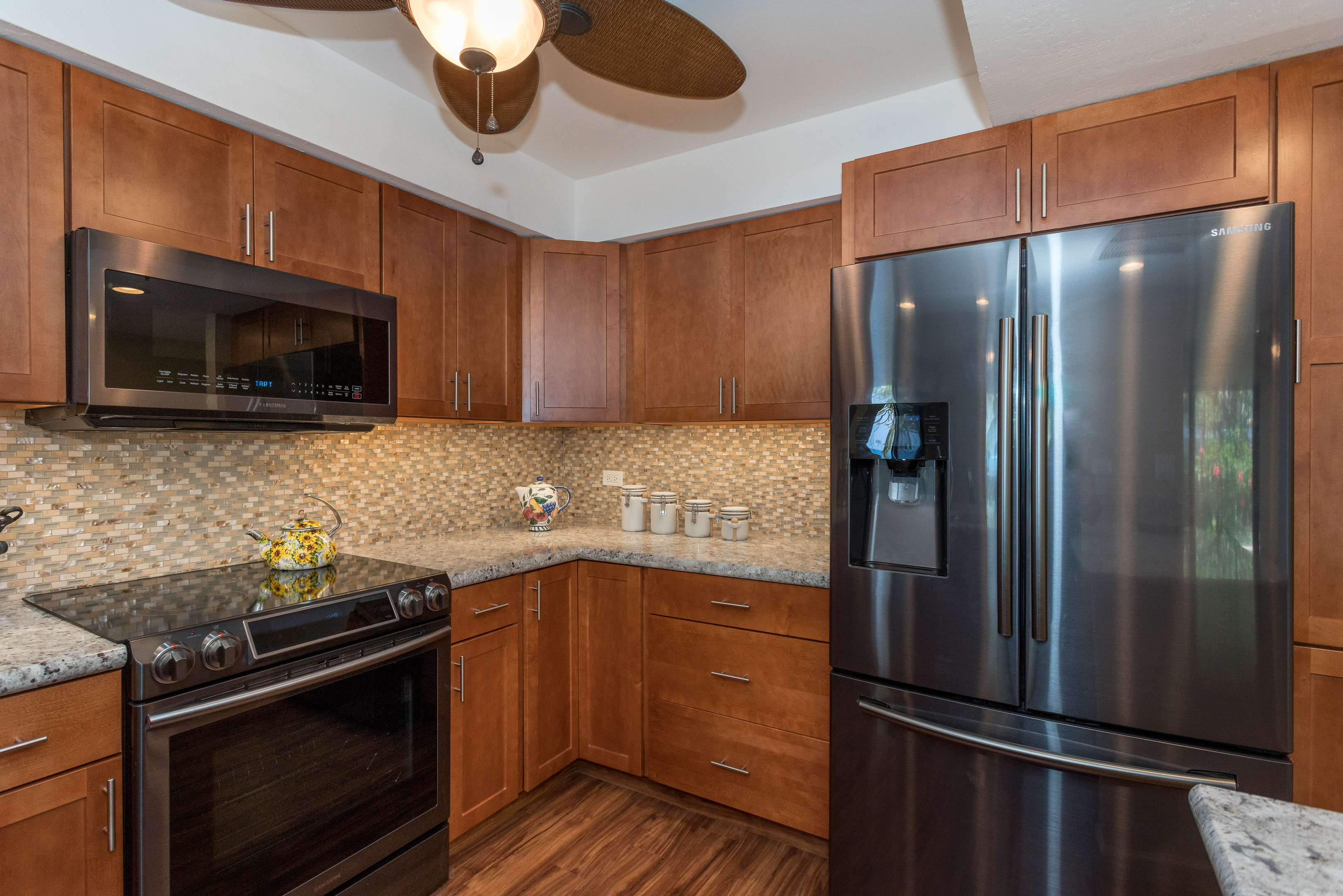Granite, tile, excellent lighting.. you will want to bring this kitchen home with you.