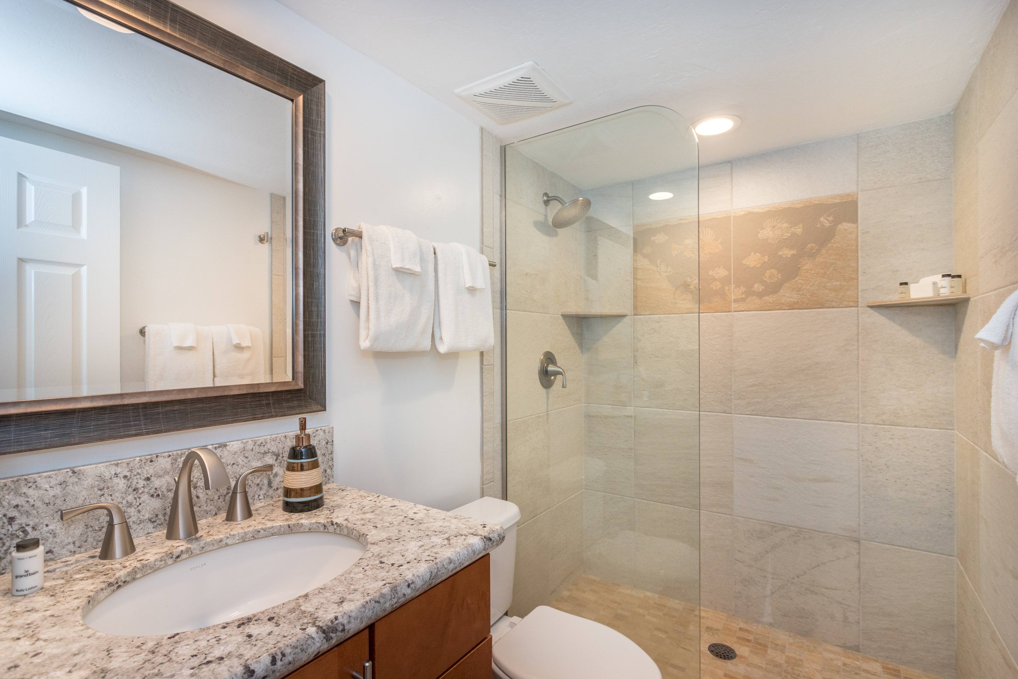 Just across the hall from the second bedroom is a new bathroom with walk in tile shower.