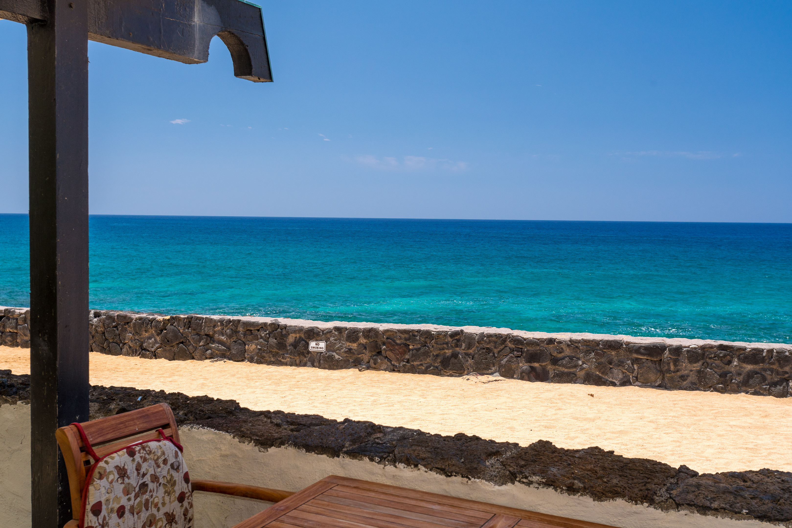Your oceanfront condo has a lovely sandy area to lounge on between you and the ocean. Very unique to the Big Island!
