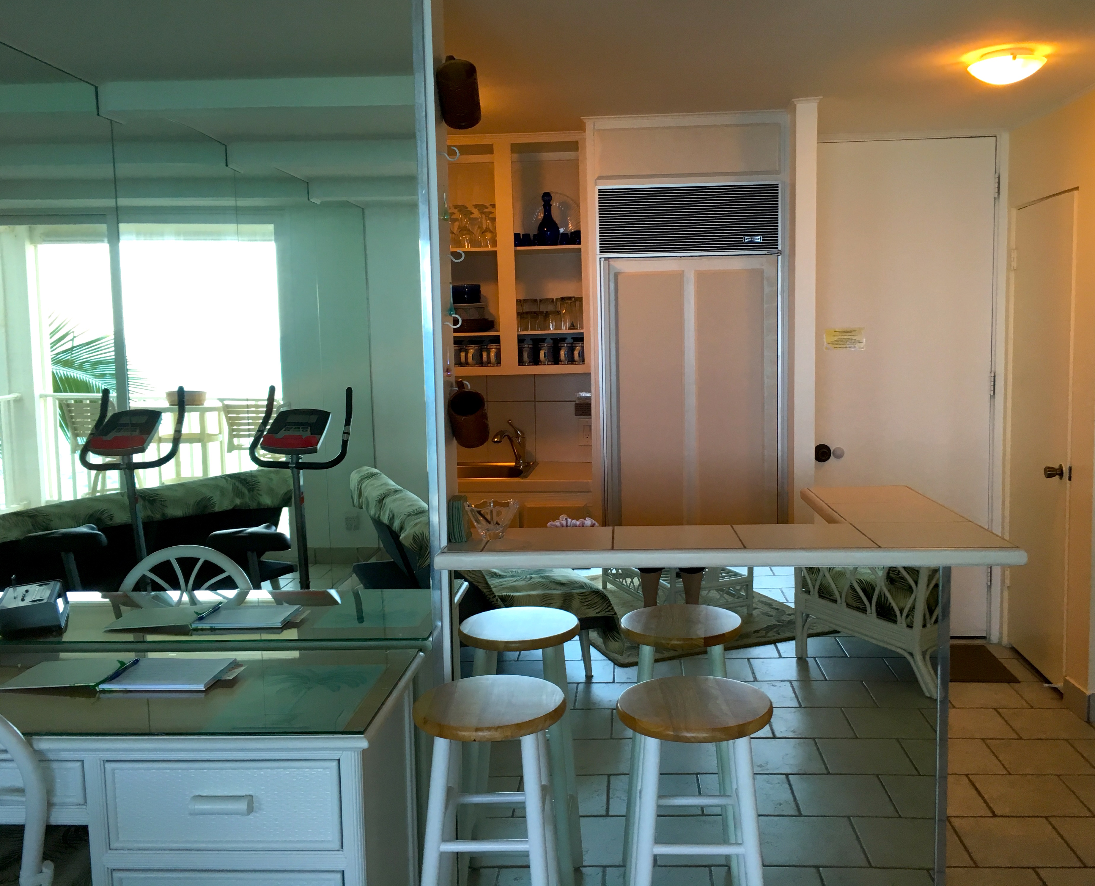 Open kitchen floor plan and desk as seen from the living room to kitchen.