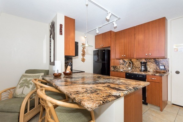 Granite counters and island dining from your new kitchen.