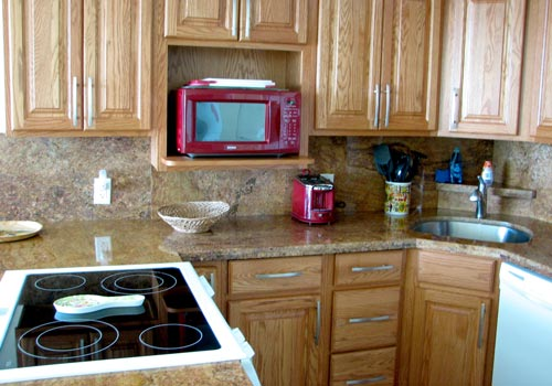 Remodeled open floor plan granite kitchen with new appliances.