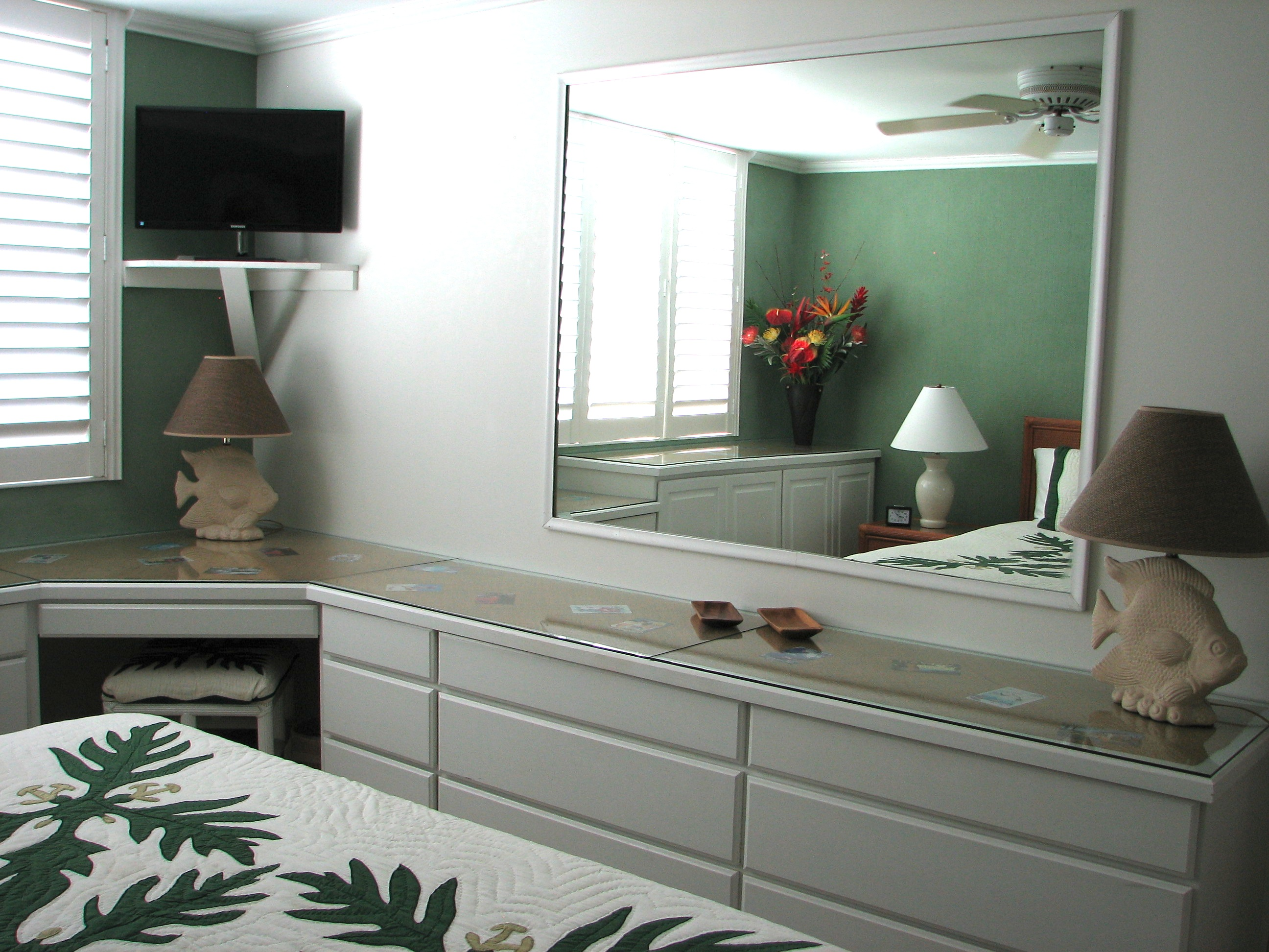 Cable TV, desk and plenty of storage in Vanity area.your private master bedroom.
