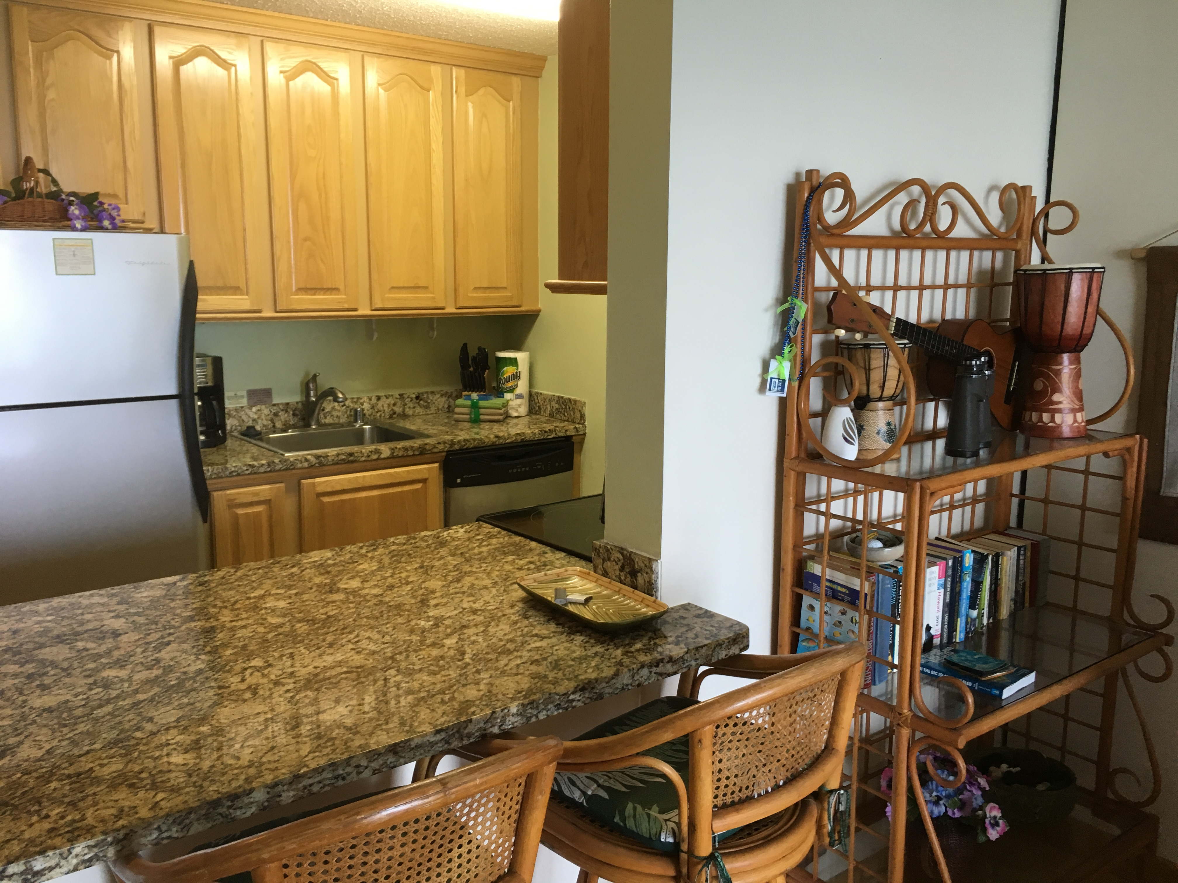 Open kitchen to living room with extra seating.