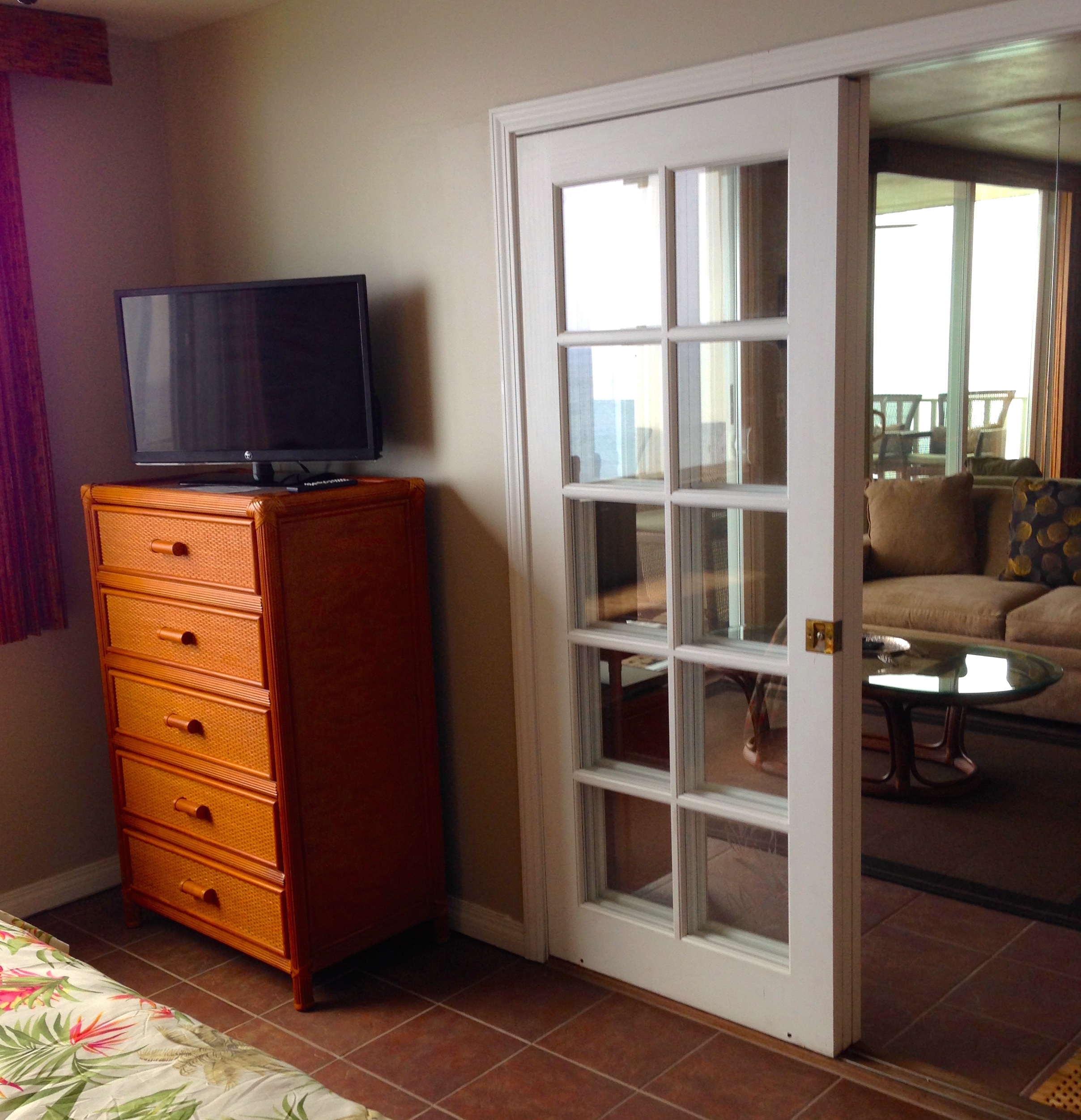 Cable TV and tall dresser in your King ensuite bedroom.