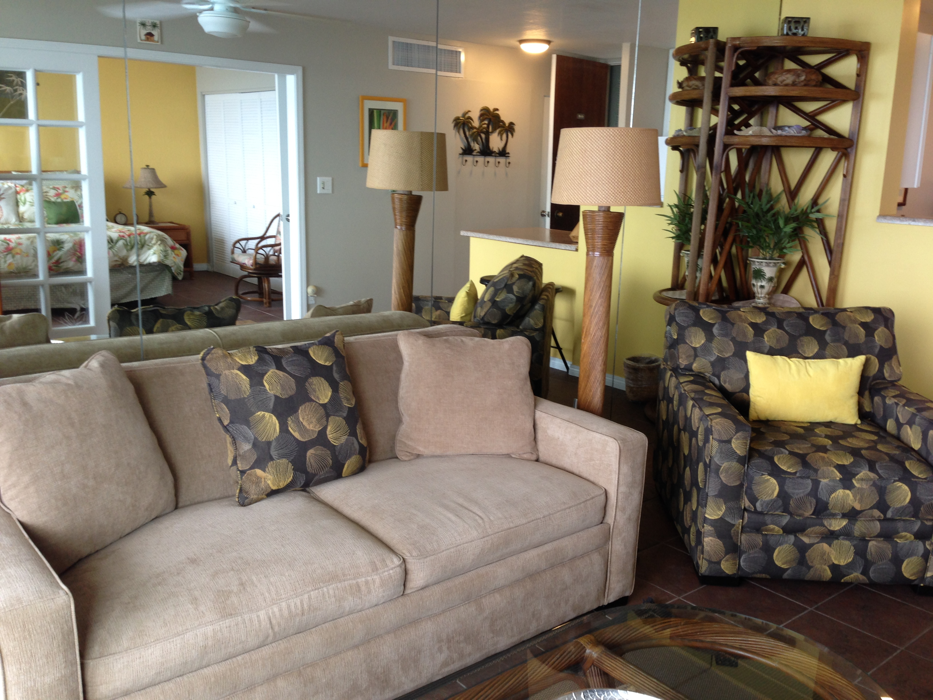 Comfortable sofa/ sofabed and oversized chair in your oceanfront living room.