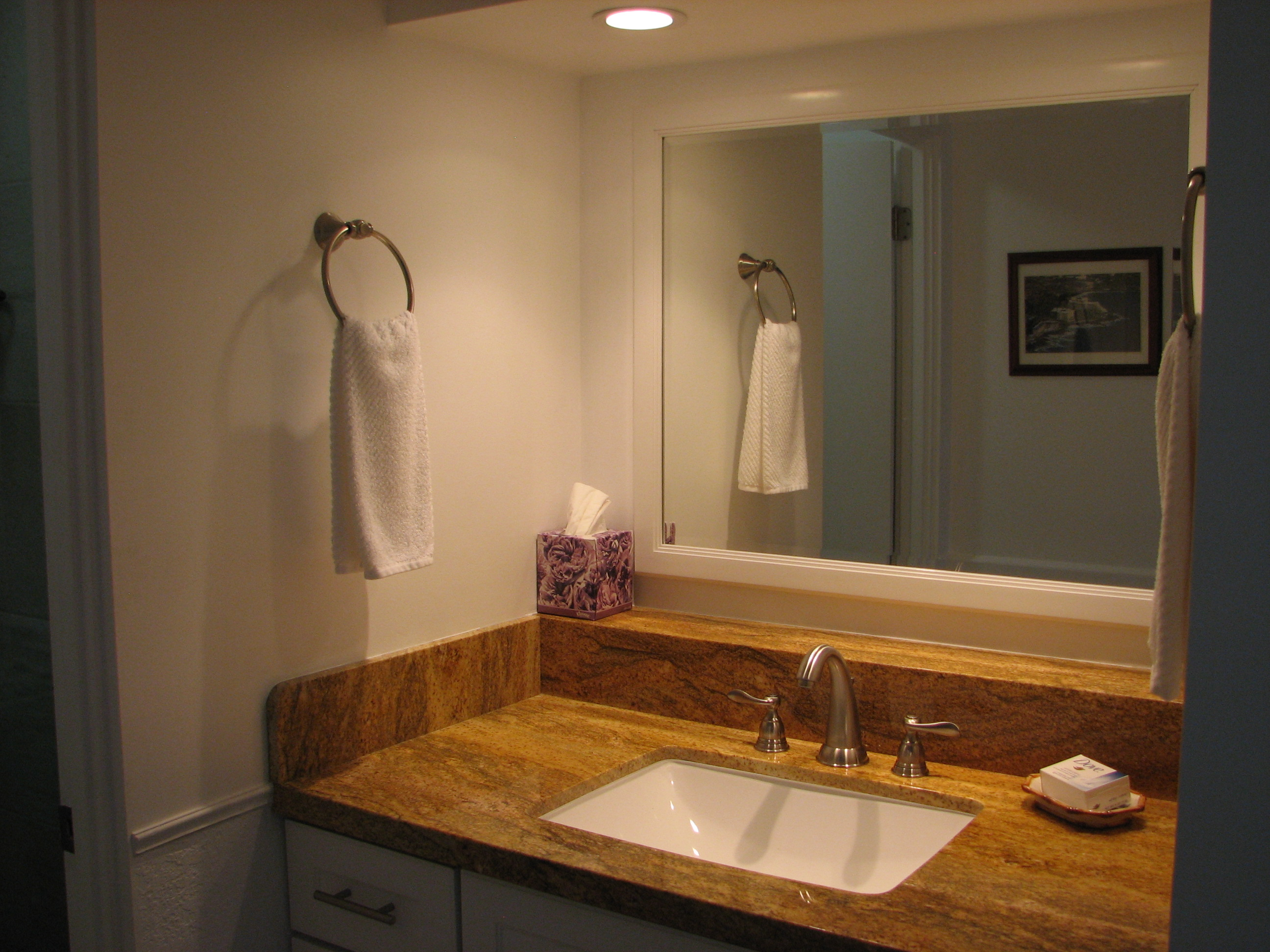 Newly remodeled granite vanity area with lots of storage.