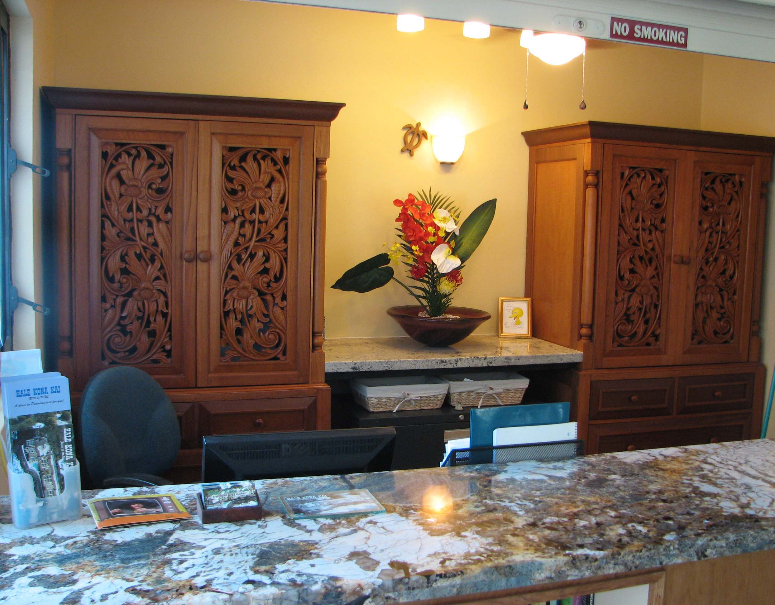 Our office is right next door at Hale Kona Kai and we are there Monday - Friday to greet you, share stories and print boarding passes... we even have a library of books for your reading pleasure.
