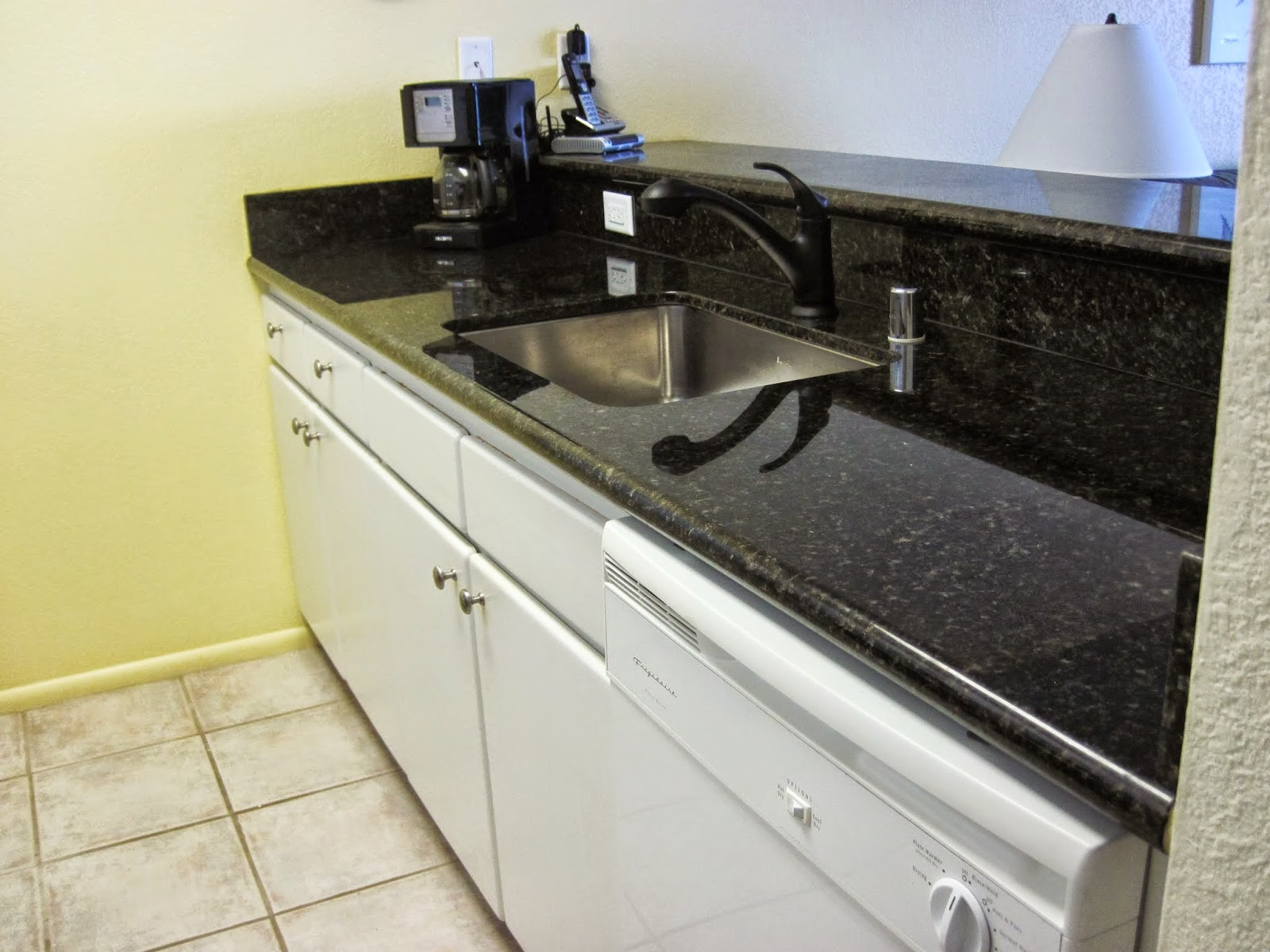 New granite counters and tile flooring.