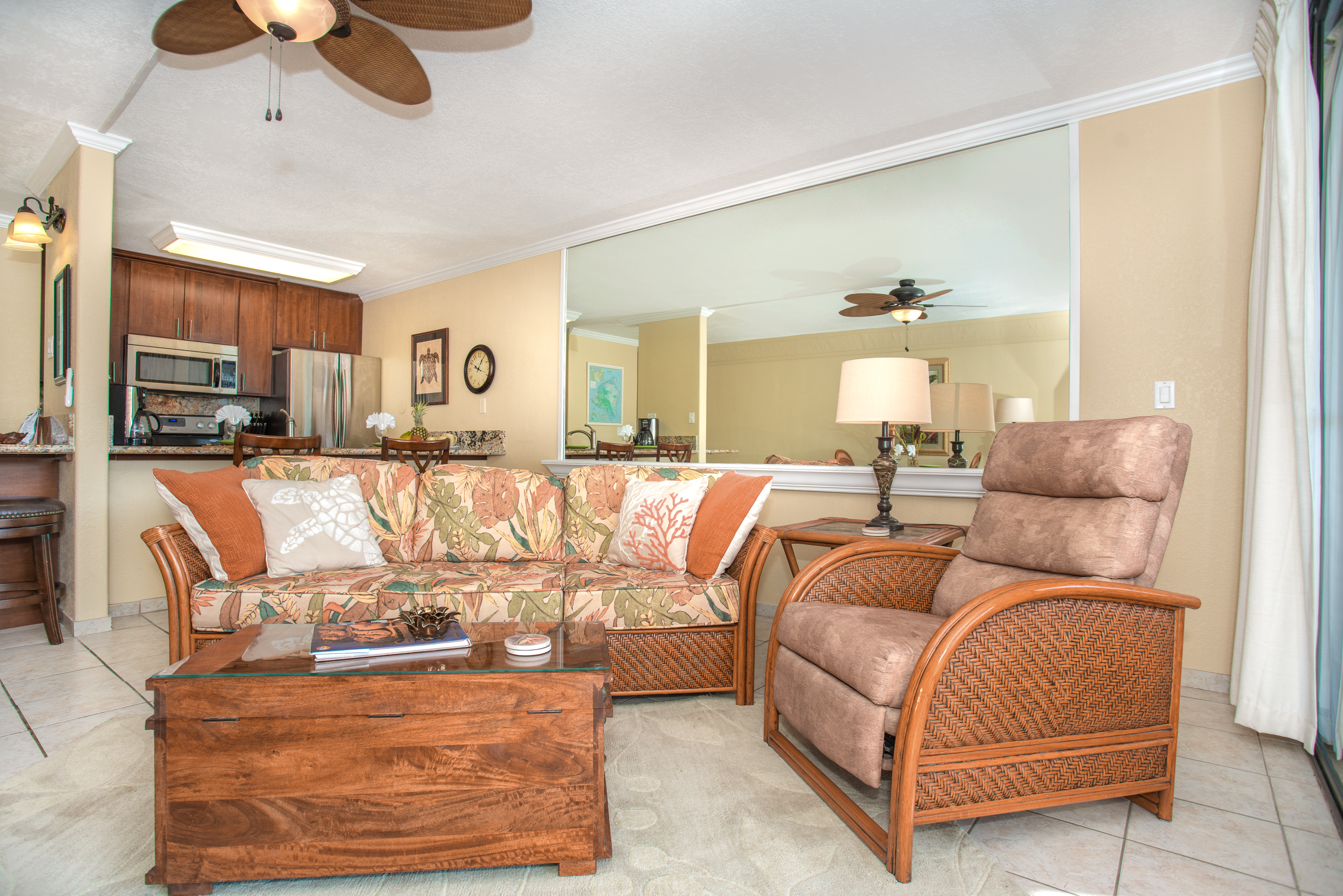 Living room with queen sofa bed and recliner.