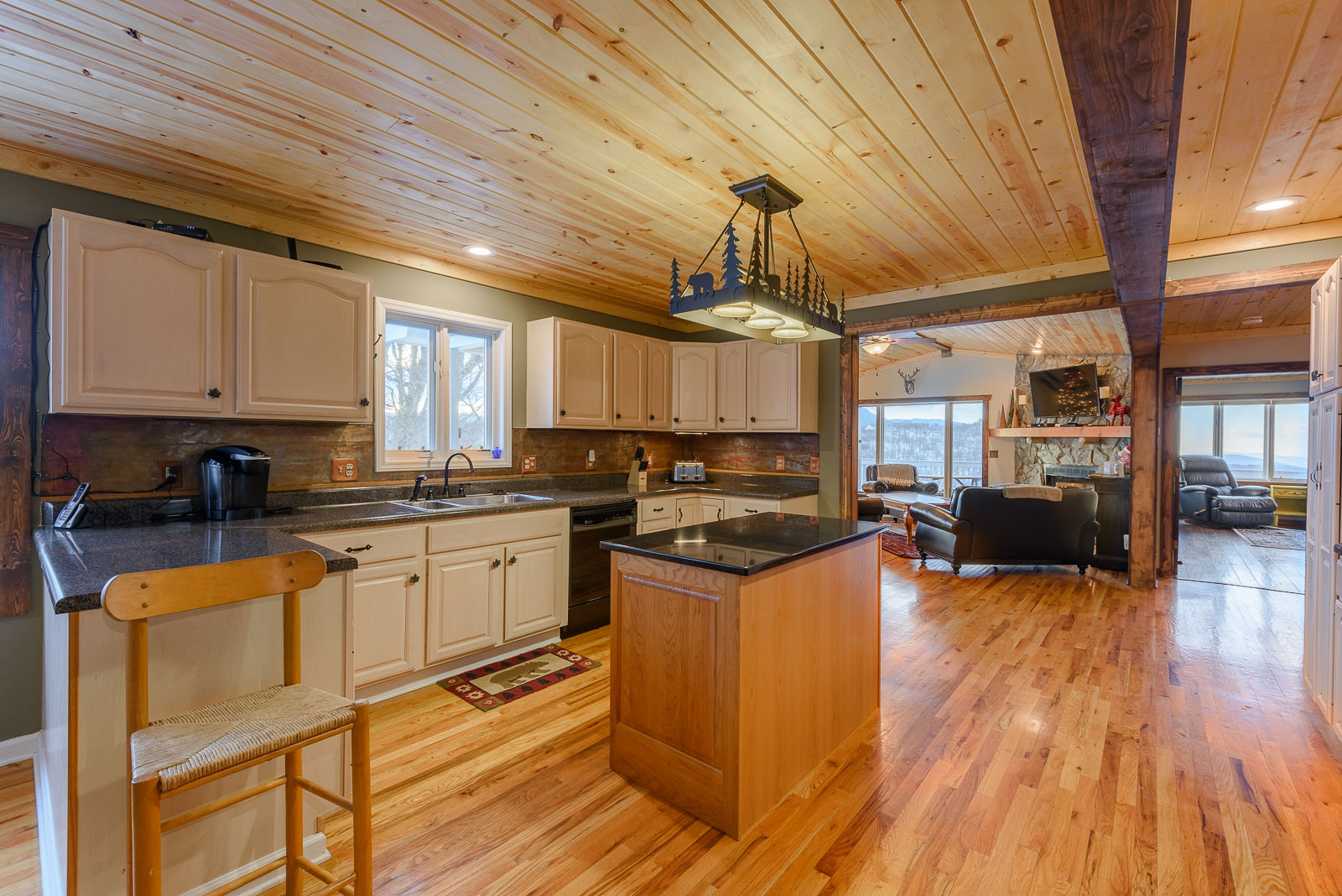 Kitchen with Hardwood Floors and Tongue & Groove Ceilings