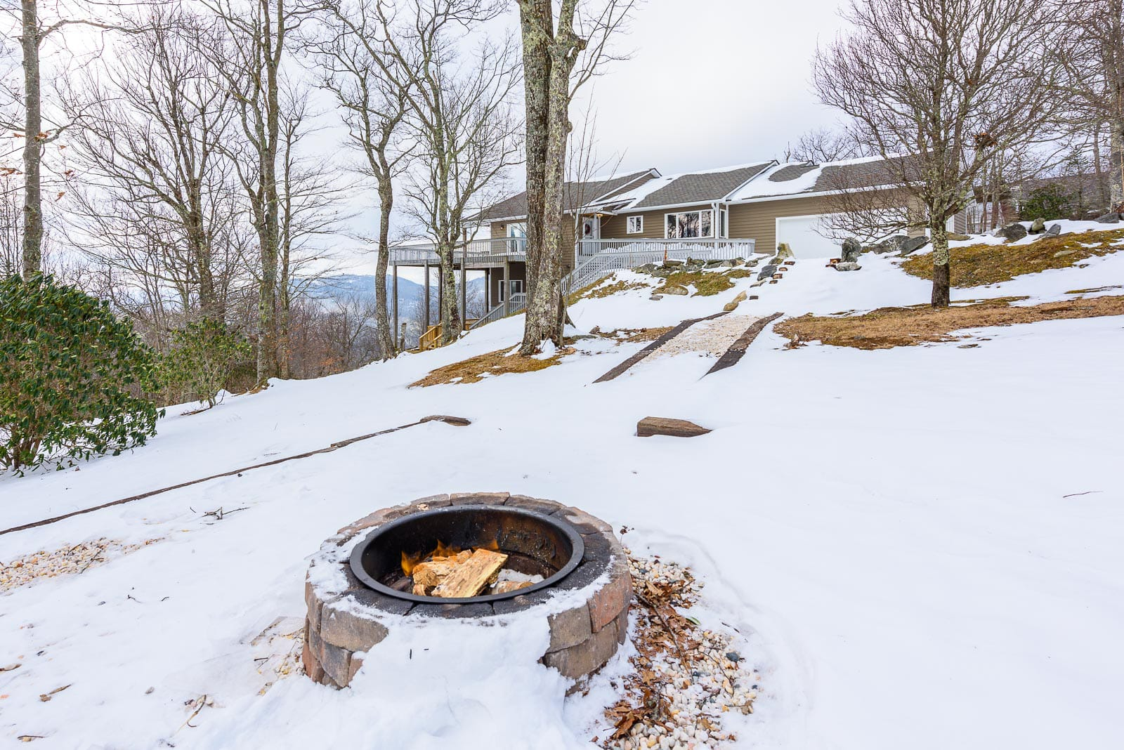 Wood Fire Pit in Side Yard, covered in Fresh Snow