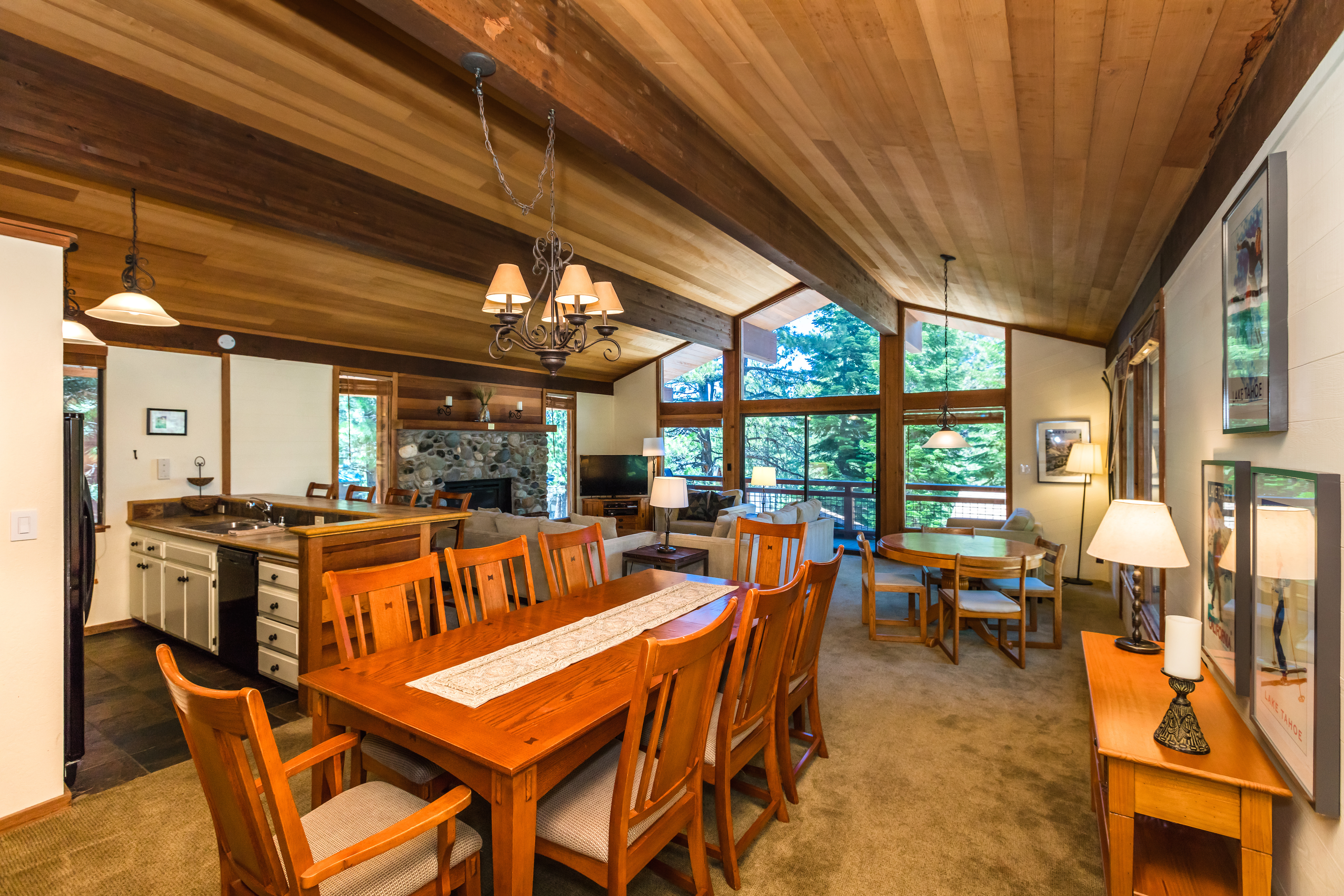 Inviting and open great room space offers dining for 8, a game table, open kitchen and great room with a gas fireplace