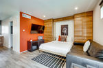 The queen Murphy bed is comfortable and inviting