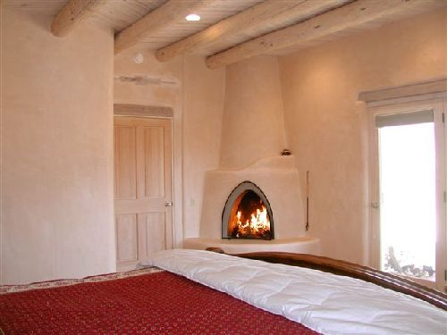 casa de los huesos 3 bedroom vacation house rental taos 10744 | taos house kiva wood burning fireplace master king bedroom 10