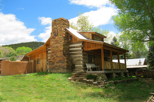 Nestled on a hill overlooking the acequia (irrigation stream
