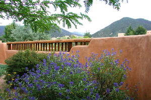 Enclosed front courtyard views to Taos mountain