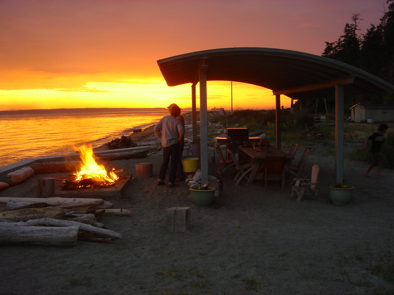 Watch the sun set at our private beach shelter