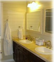 All bathrooms have granite tops,  travertine floors and back
