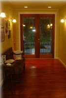 Gorgeous entry hallway;  all walls are painted horizontal pi