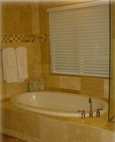 Tub for two,  and separate glass enclosed shower in master b