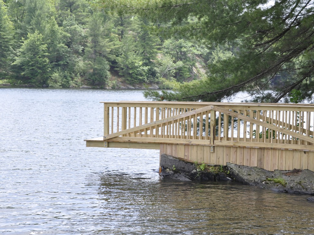 Diving deck, raft, and sandy beach are great for swimming.