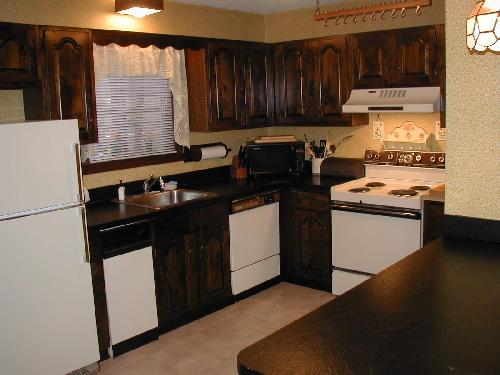 Kitchen  with stove and refregirator