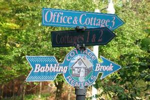Street Signs to Babbling Brook Cottages in Dingmans Ferry Resort