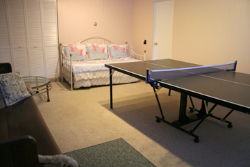 recreation room with ping pong table and trundle bed