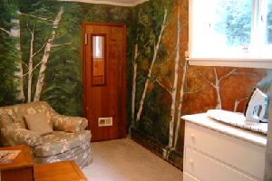 sauna room with painting of the changing seasons