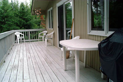 side deck with gas grill, table,  4 chairs & a Mountain View