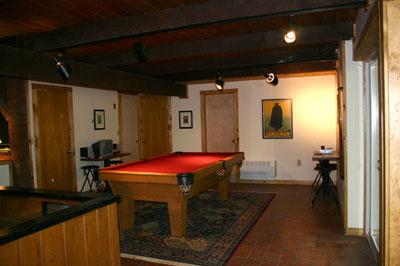 The 8\' oak pool table is adjacent to the sunken fireplace
