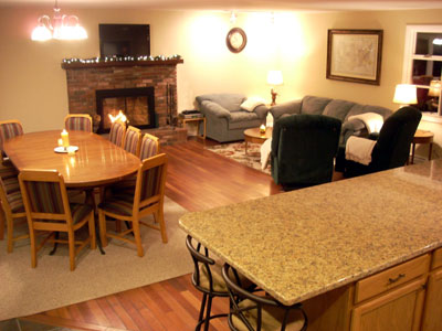great room with dining table for 10, fireplace, living room,