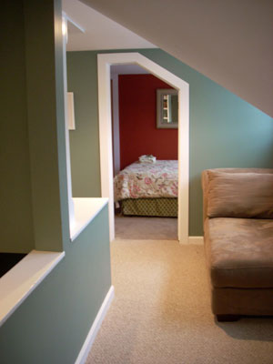 upstairs hall w/reading nook & lots of books