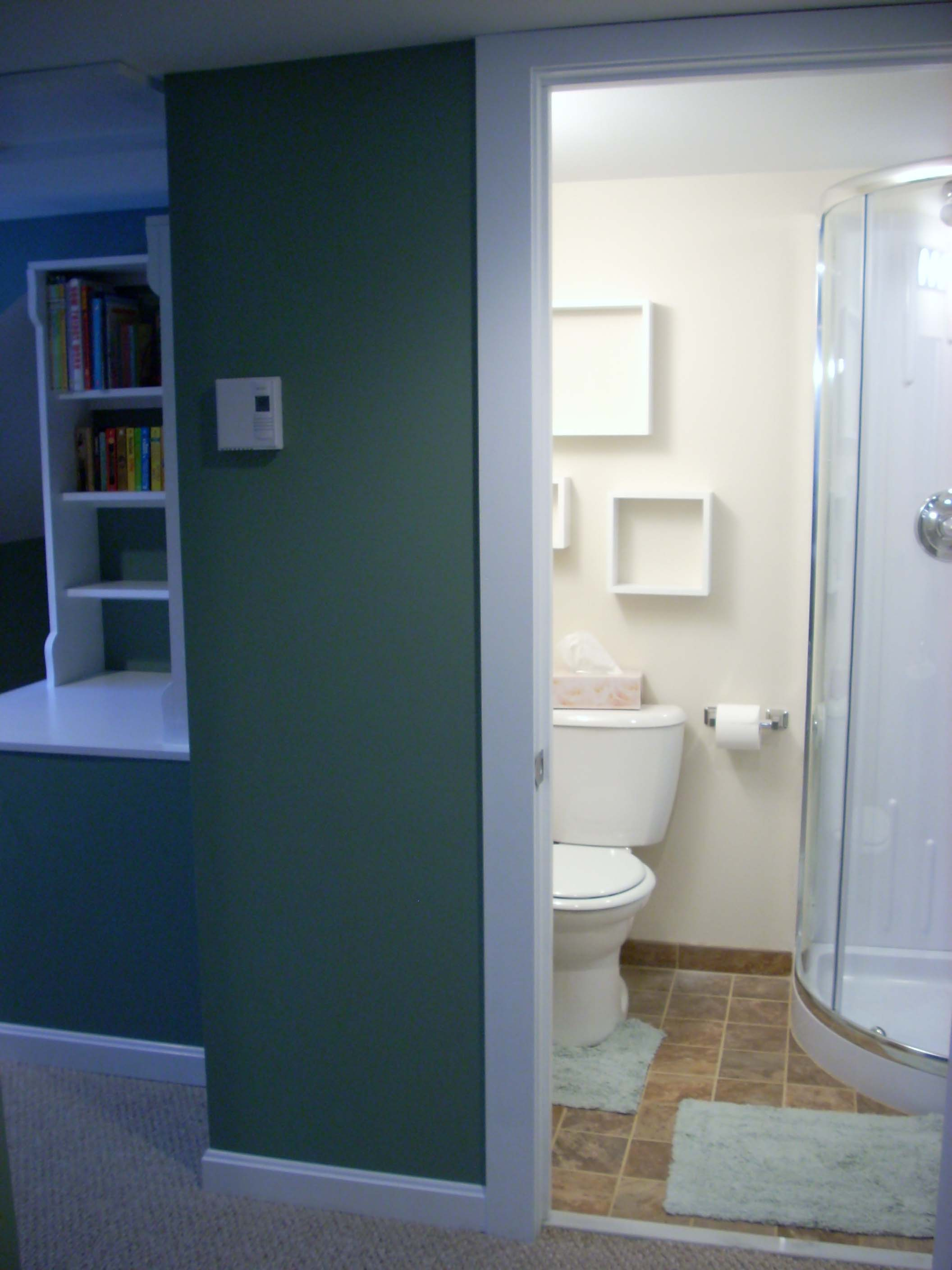 upstairs small bath with shower stall & pedestal sink