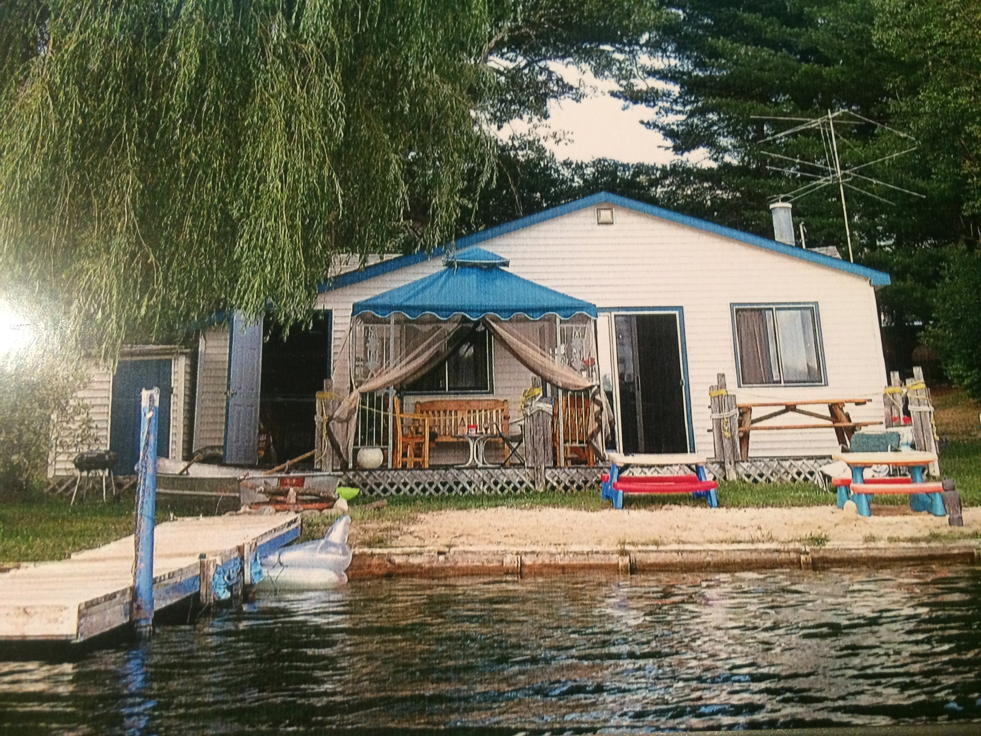 cottage featured property lakefront michigan shadyshore cottages in for parkway mi sale waterfront elmira