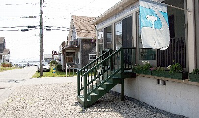 Steps to Enclosed Porch.  Steps to Beach.