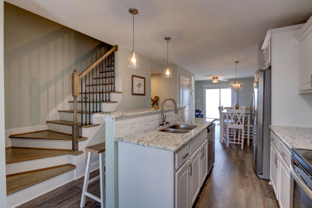 Middle Level Kitchen Leads Upward to Master Suite