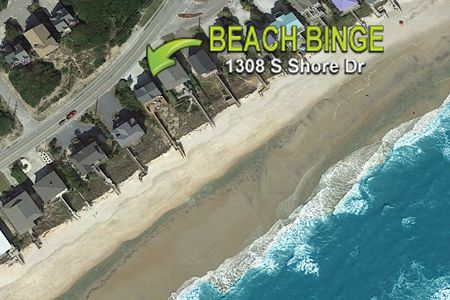 Aerial View of Property and Beach