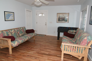 Large foyer doubles as a game room and has 2 double futons