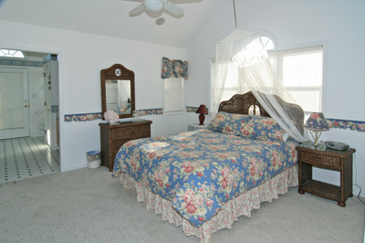 Master bedroom on 3rd level with queen bed