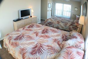 Master bedroom with 2 queens, deck access 2 sides
