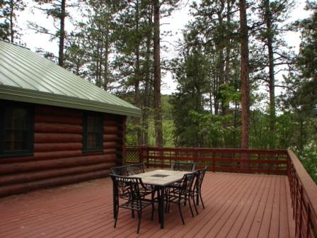 Large patio with wrap around deck at this cabin in Keystone